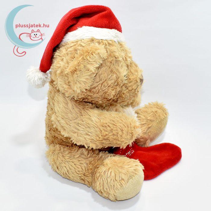 Plüss maci babáknak, karácsonyi zoknival oldalról