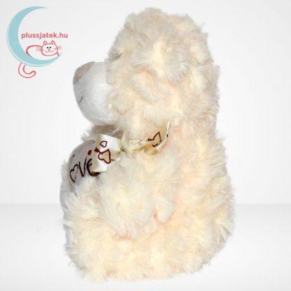 Valentin napi fehér szerelmes maci, plüss szívvel, oldalról