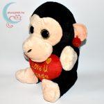 Hatalmas csillogó szemű szerelmes plüss majom balról