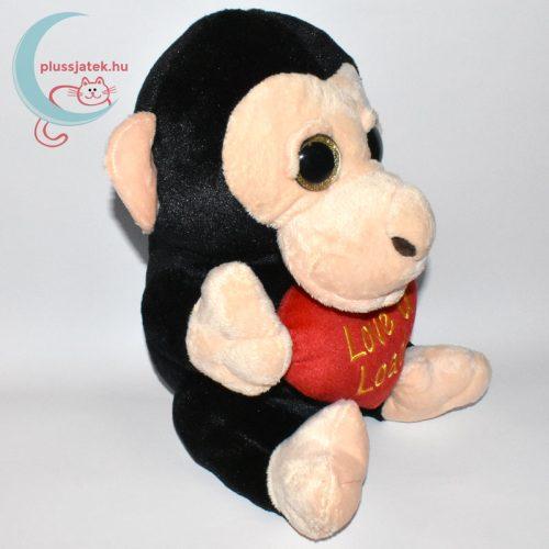 Hatalmas csillogó szemű szerelmes plüss majom jobbról