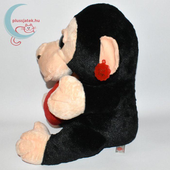 Hatalmas csillogó szemű szerelmes plüss majom oldalról